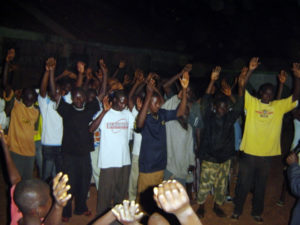Hands raised during an altar call.