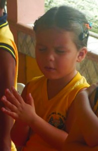 Learning to pray at Noah's Ark Christian School.