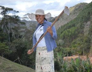 Ana Paula digging holes to plant guava trees.