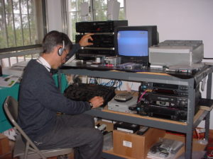 Billy Paúl preparing a radio program for broadcast.
