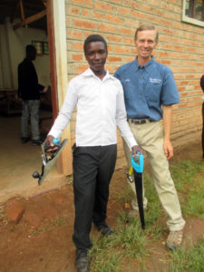 Gift, with Elisha, receiving his carpentry tools.