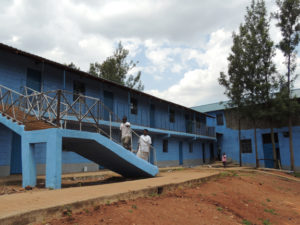New school with the dormitory for the girls in the background.